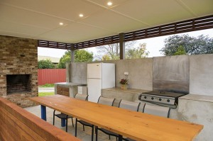 motel meneres outdoor kitchen & fireplace